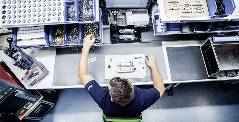 Employee assembling something | TELAIR